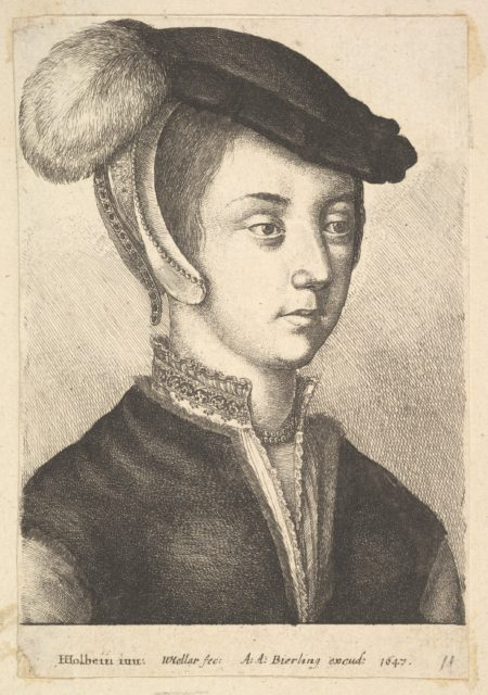 Young woman wearing a feathered cap