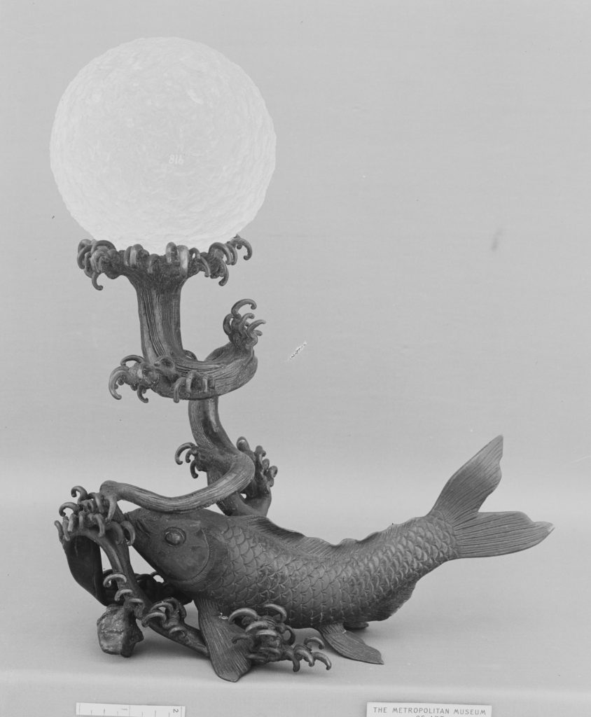 Crystal Ball on a Bronze Stand in the Shape of a Fish