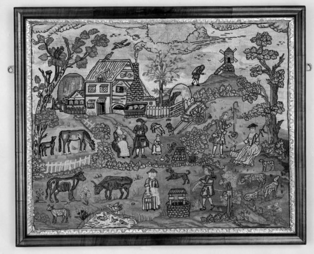 Embroidered picture with farmyard scene