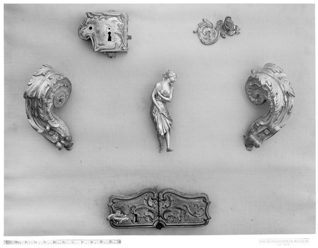 Parts of a pair of andirons