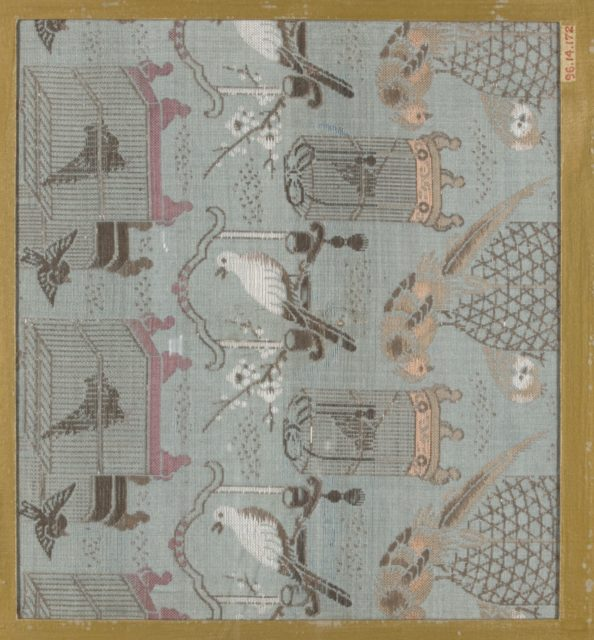 Textile fragment with incomplete repeating pattern of birds and bird cages