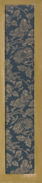 Textile fragment with pattern of Chinese boys on flowering branches