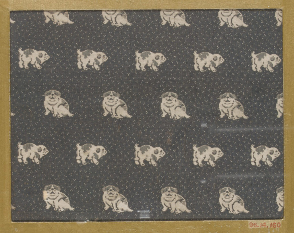 Textile fragment with repeating pattern of dogs on dotted ground