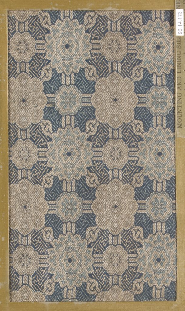 Textile fragment with repeating pattern of floral medallions in latticework on swastika-fret ground