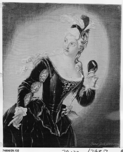 Young Woman Holding a Mask
