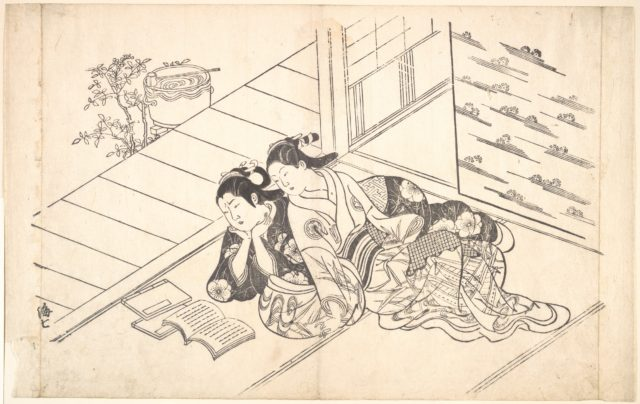 Two Women Reclining on the Floor of a Room and Reading a Book