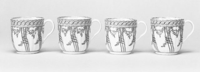 Four coffee cups (part of a service)