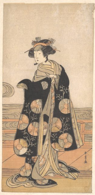 Yoshizawa Iroha as a Woman Standing on the Engawa of a House by a River