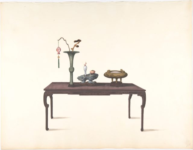 Long Dark Table with Decorative Objects