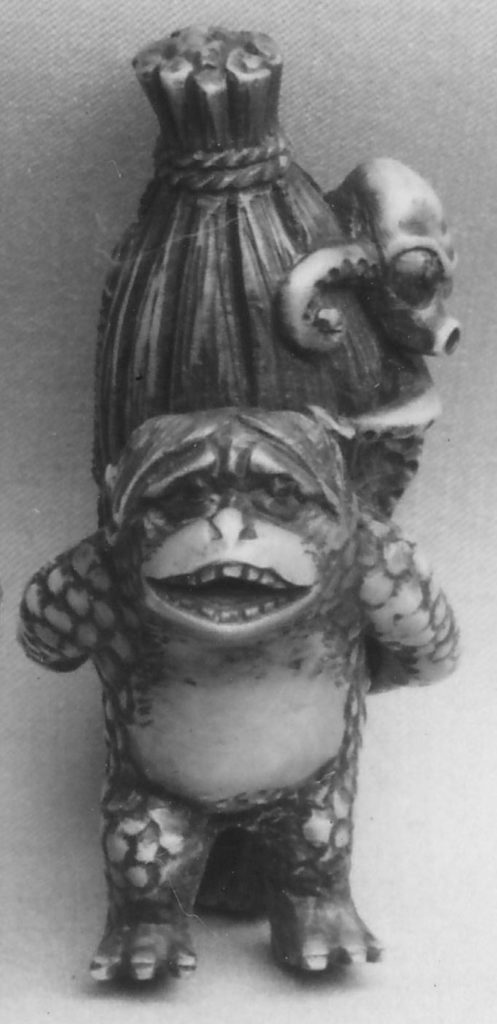 Netsuke of Monkey Carrying an Octopus Bound in Bamboo on His Back