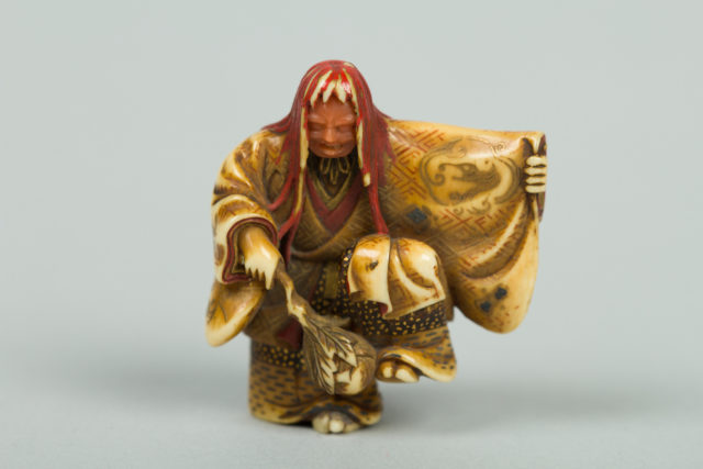 Netsuke of Noh Dancer with Long Red Hair and Peony