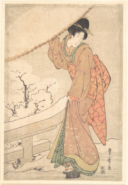 A Young Woman in a Snow Storm Carrying a Heavily Snow-Laden Umbrella