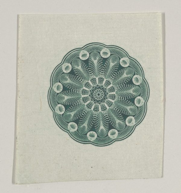 Banknote motif: small circular ornament containing floral lathe work
