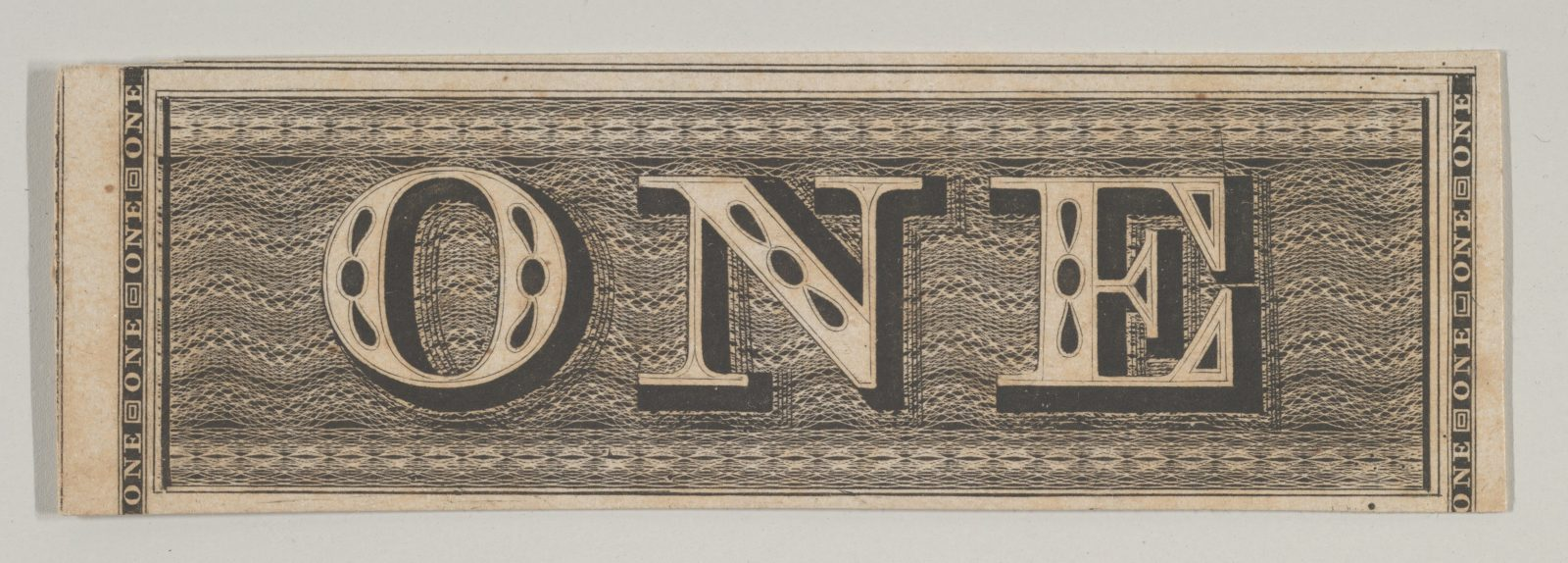 Banknote motif: the word ONE set against a rectangular band of lathe work