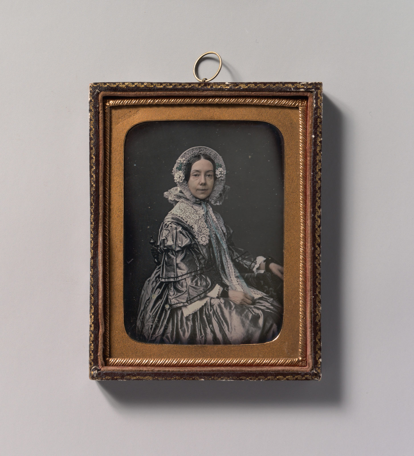 [Seated Middle-aged Woman Dressed in Finery]