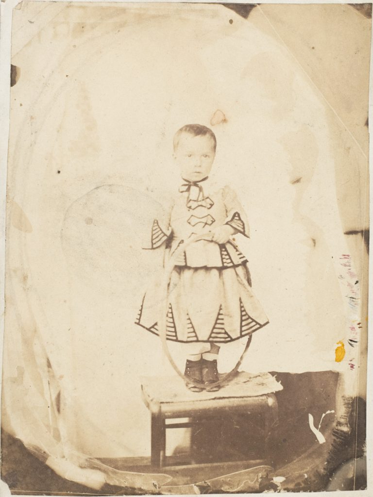 [Child Posed with Hoop]