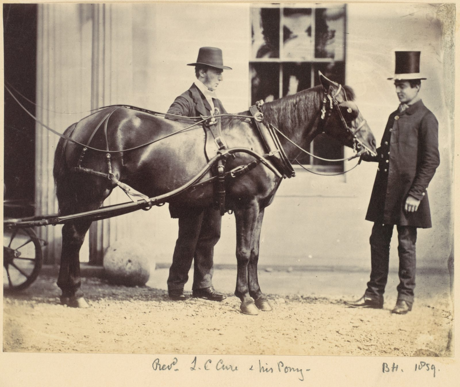 Reverend L. C. Cure and His Pony