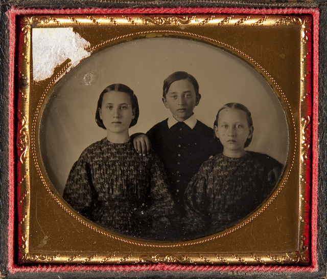 Portrait of two girls and one boy
