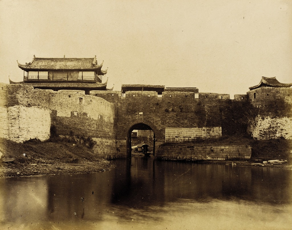 Walled River and Bridge with Buildings Above