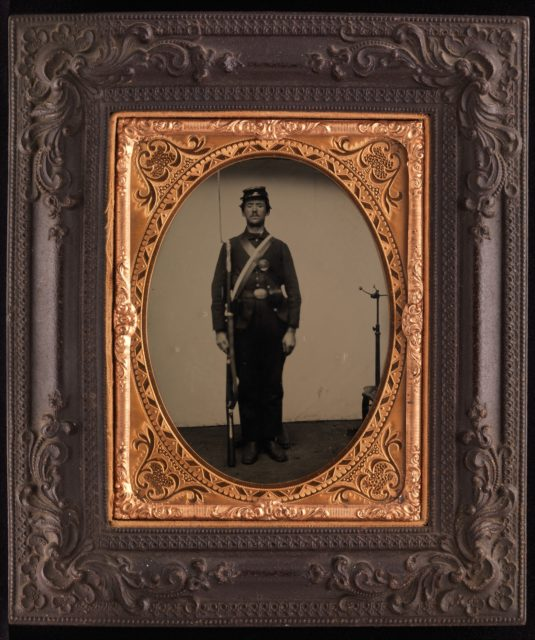 [Union Soldier Holding Rifle, with Photographer's Posing Stand]