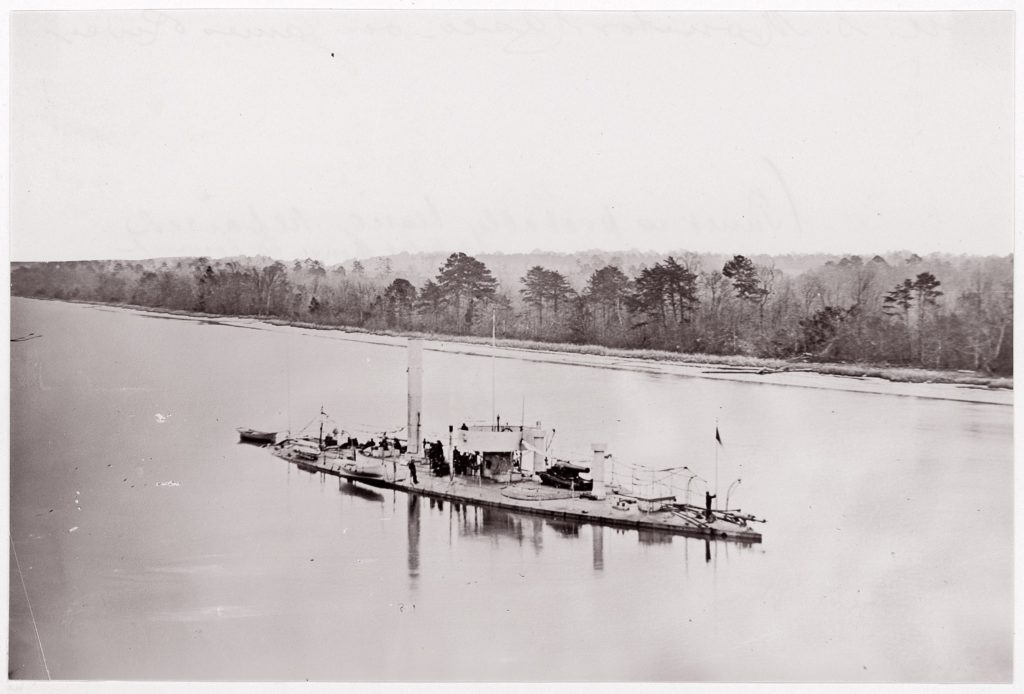 """U.S. Monitor """"Casco"""" on James River, taken from a lookout tower on bank."""