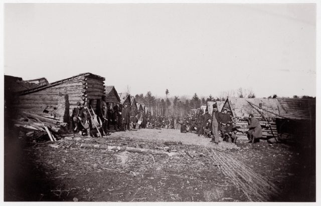 [Winter Quarters, troops with row of cabins].  Brady album, p. 128