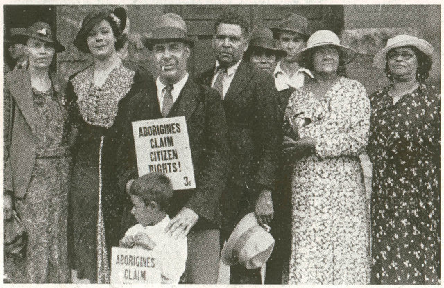 Group of Aborigines with protest sign