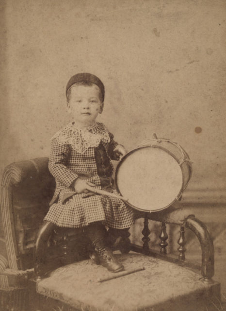 Portrait of boy with drum, date unknown