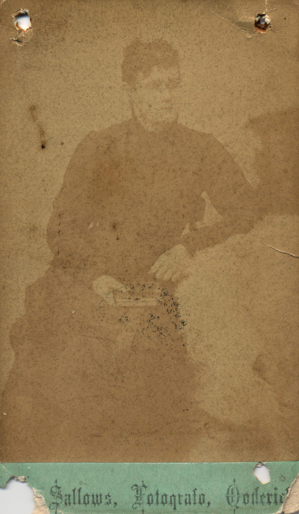 Portrait of woman holding book, date unknown