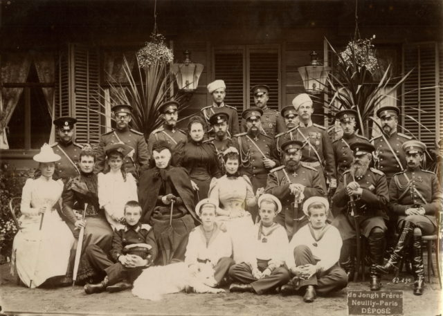 Emperor Alexander II, Empress Maria Feodorovna, members of the Romanov family and a group of army officers.