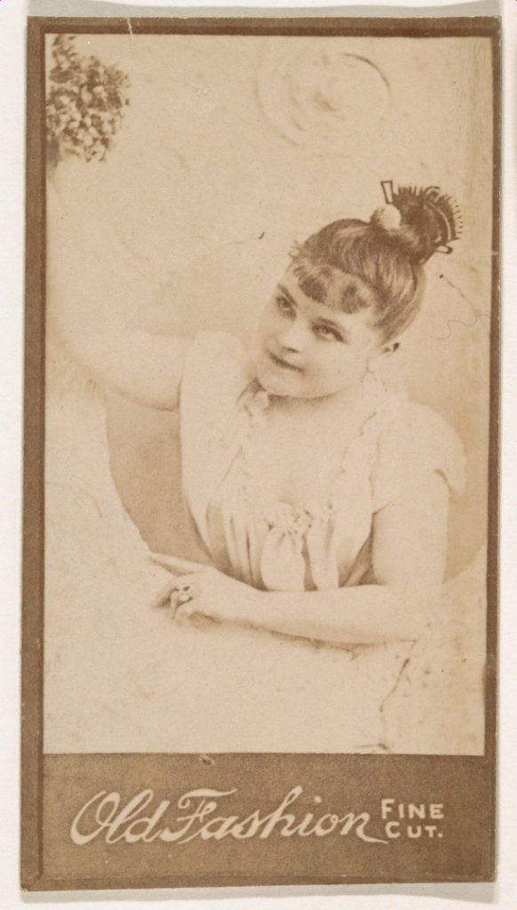 Actress holding bouquet aloft, from the Actresses series (N664) promoting Old Fashion Fine Cut Tobacco