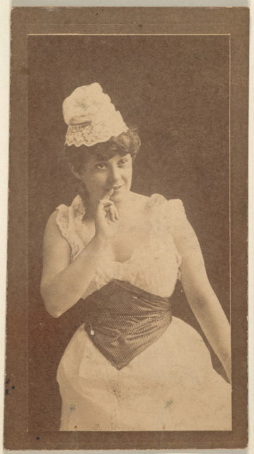 Actress holding finger up to lips, from the Actresses series (N668)