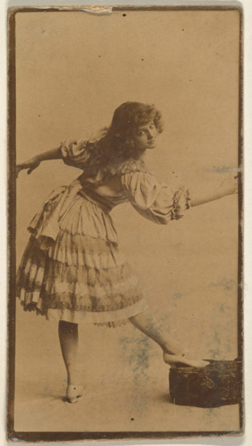 Actress posing with foot on cushion, from the Actresses series (N668)
