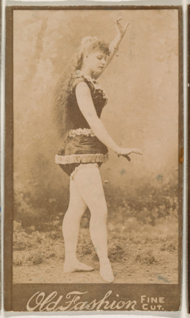 Actress posing with one arm aloft, from the Actresses series (N664) promoting Old Fashion Fine Cut Tobacco