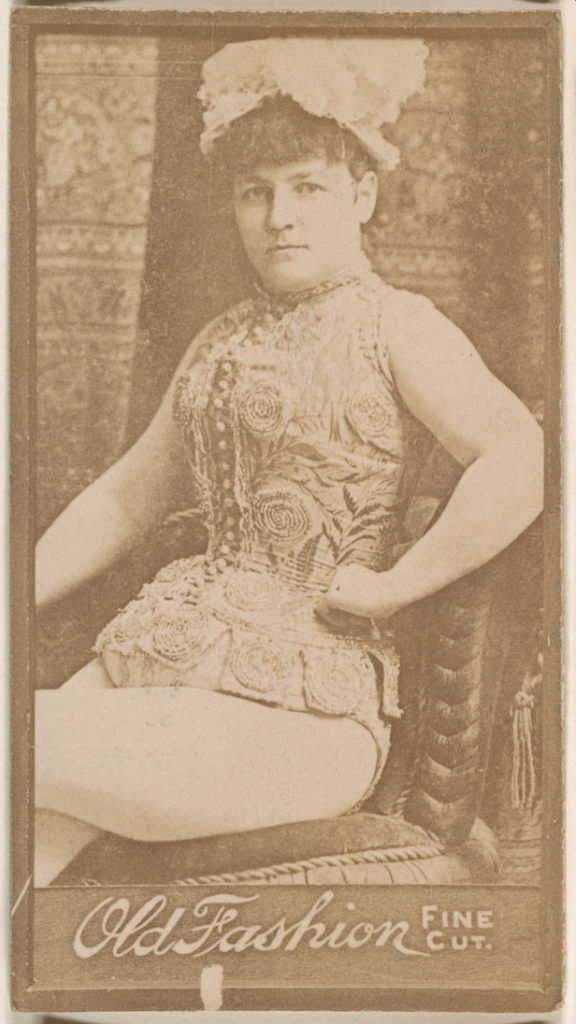 Actress seated in chair, from the Actresses series (N664) promoting Old Fashion Fine Cut Tobacco