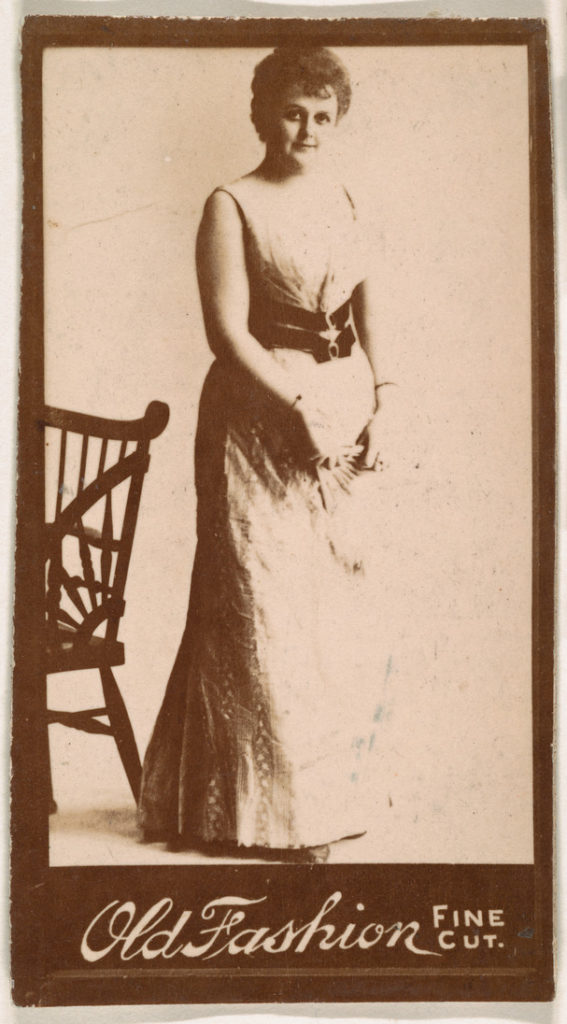 Actress standing next to chair, from the Actresses series (N664) promoting Old Fashion Fine Cut Tobacco
