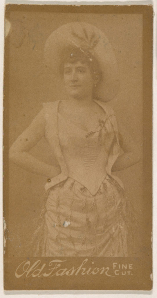 Actress standing with hands on hips, from the Actresses series (N664) promoting Old Fashion Fine Cut Tobacco