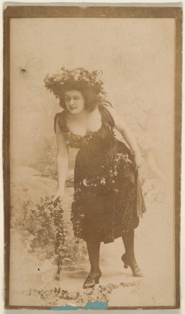 Actress wearing costume with floral headpiece, from the Actresses series (N668)