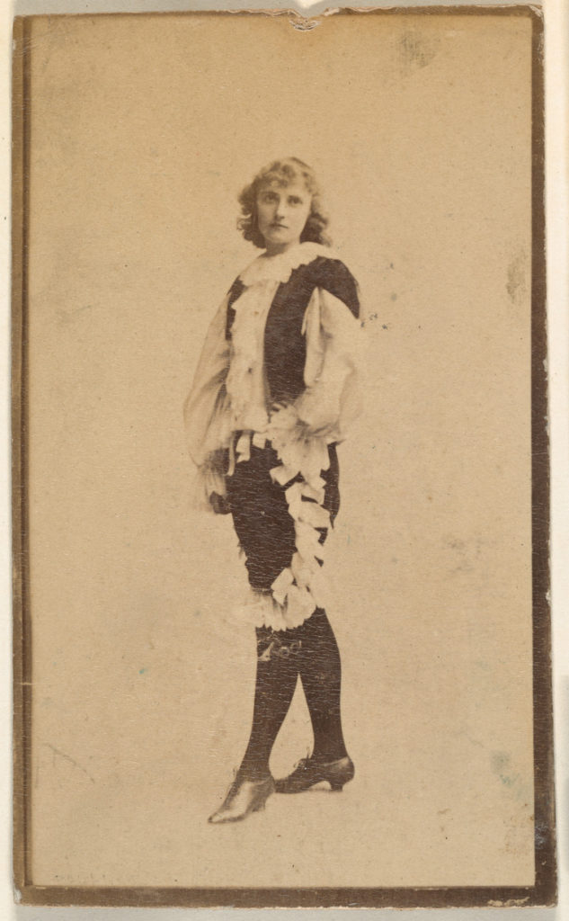 Actress wearing costume with ruffled blouse and trousers, from the Actresses series (N668)