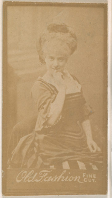 Actress with finger held to lips, from the Actresses series (N664) promoting Old Fashion Fine Cut Tobacco