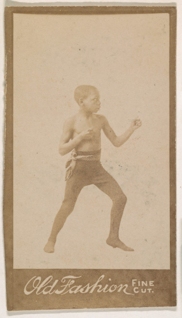 """Child standing in boxing stance, from the """"Negro Subjects"""" series (N692) promoting Old Fashion Fine Cut Tobacco"""