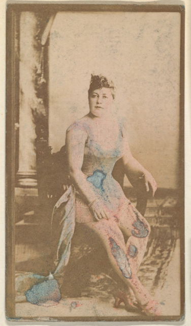 Seated actress blue hand-colored gown, from the Actresses series (N668)