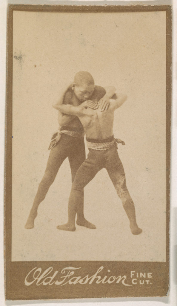 """Two boys wrestling, from the """"Negro Subjects"""" series (N692) promoting Old Fashion Fine Cut Tobacco"""