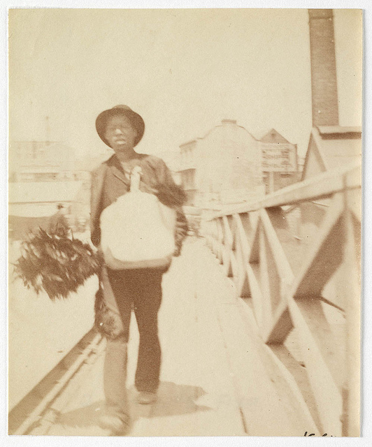 A chimney sweep [?] walking across Pyrmont Bridge  Sydney, ca. 1885-1890 / photographed by Arthur K. Syer