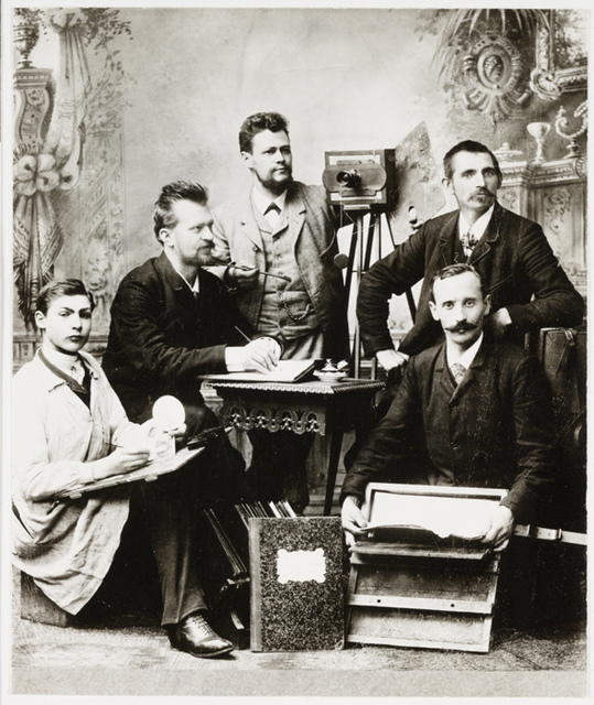 Group of photographers posing in a studio