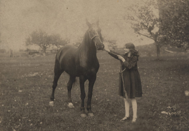 Young girl and horse, date unknown