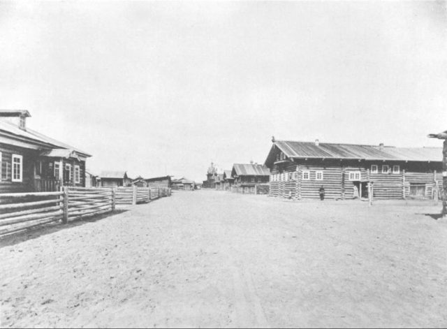 The school (left) and the home of the sister of Father John. The village of Sura on the Sura River. Archangel region, 1891