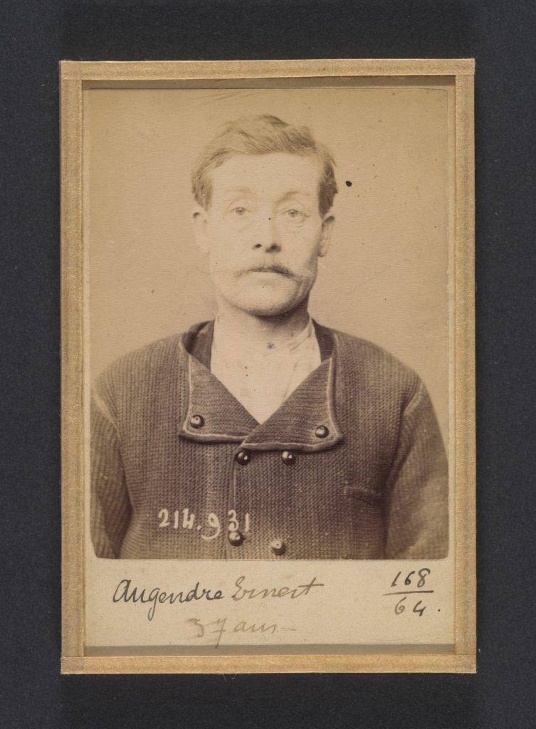 Augendre. Ernest. 37 ans, né à St-Pierre le Moutier (Nièvre). Maçon. Anarchiste. 1/3/94.