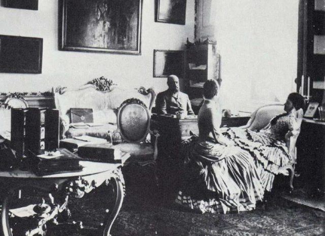 Emperor of Russia Alexander III in cabinet with his family