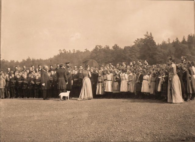 Emperor Alexander III and Empress Maria Fedorovna during a meeting with children